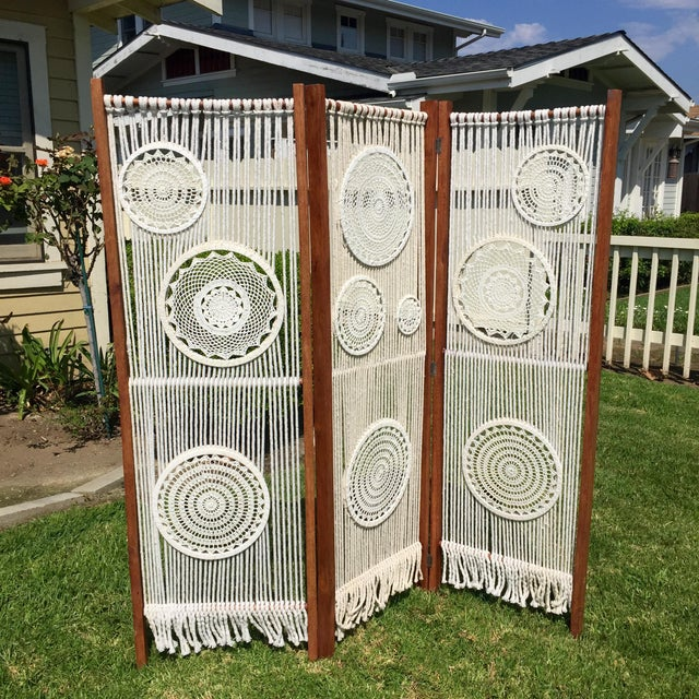 This is a super cool, macrame, folding room divider. It has rope work with doily pattern accents and is mounted on a...