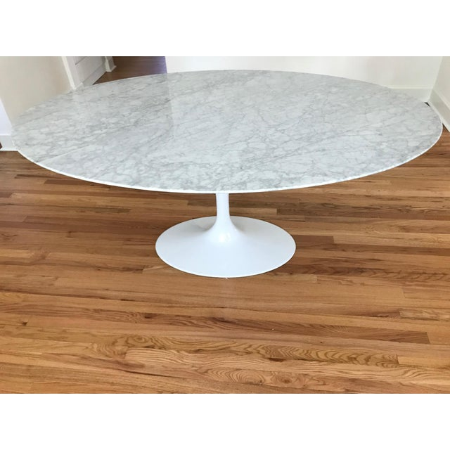 """Stunning and beautiful 67"""" oval carrara marble top and glossy white cast aluminum base. Beveled underside edge. Solid and..."""
