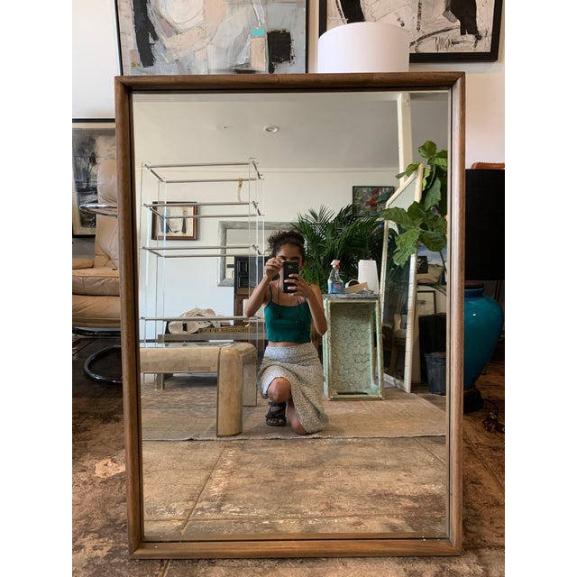 Simple and Classic Mid Century Modern Walnut Mirror. Item features solid wood frame, beautiful wood grain, clean modernist...