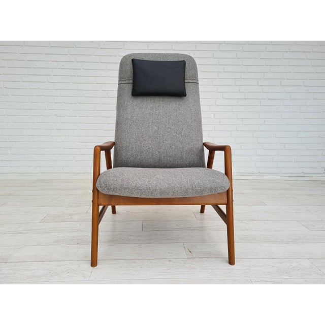 """Danish design by Alf Svensson, model """"Kontour"""". Completely renovated-reupholstered high-backed armchair with stained solid..."""