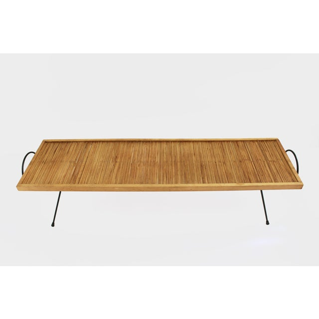 An innovative, low-slung wood and steel coffee table designed in 1949 by Katavolos, LIttell and Kelly for the eclectic,...