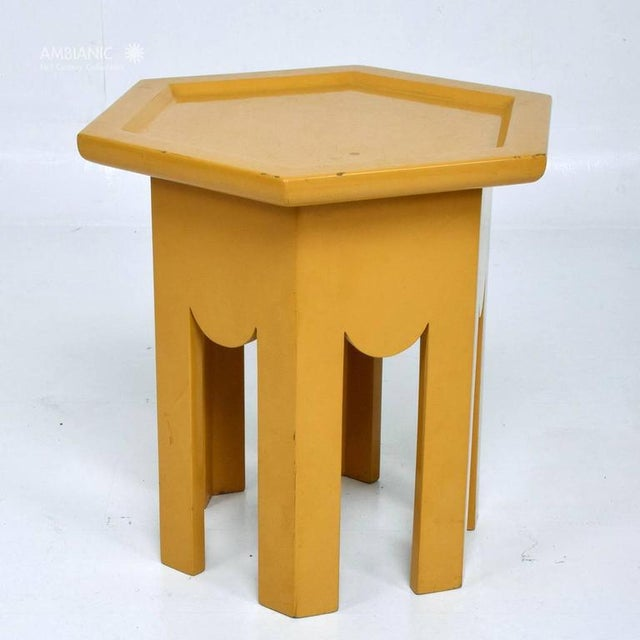 For your consideration a vintage side table with hexagon shape and original finish in yellow lacquer. Unmarked. No...