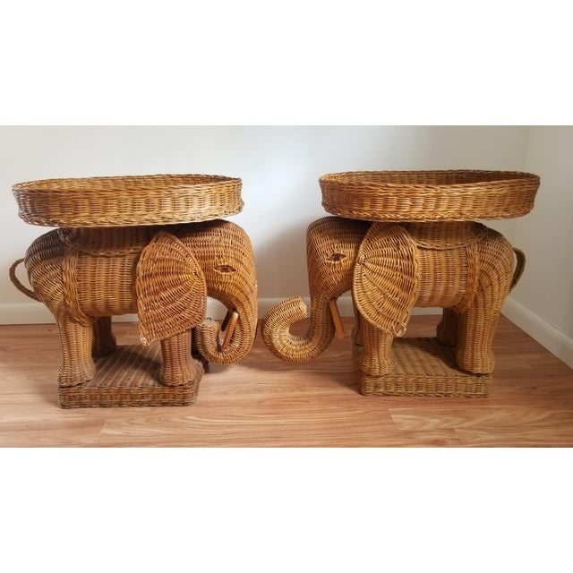 Pair of striking Italian woven rattan elephant side tables with removable tray tops. Artisan made in natural, woven...