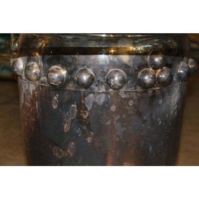 An nice silver plated Asian drum that has been made into a table by adding a 36 inch diameter piece of glass. The top is...