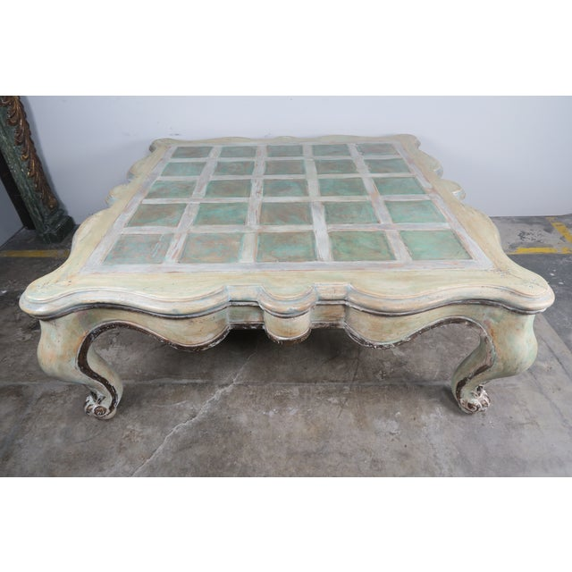 Monumental Scaled Square scalloped shaped French Painted Coffee Table standing on four cabriole legs with rams head feet....