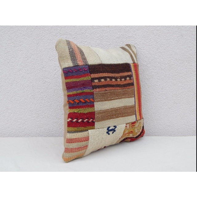 This handwoven kilim pillow is made from Anatolian and Middle-eastern kilim fragments. Each of our kilim pillow covers is...