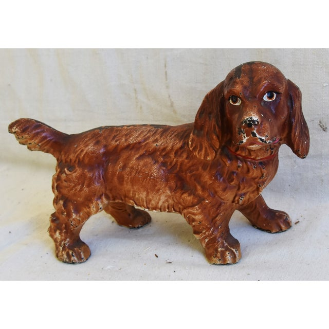 Vintage cast iron dog figure. Perfect as a doorstop. No maker's mark. Minor age wear/patina.
