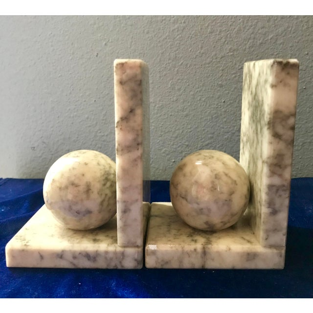 Vintage marble book ends with a high polish finish. Geometric in style with round ball featured in front of rectangular...