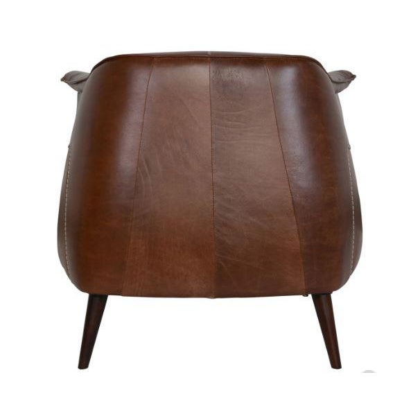 Yummy leather, in the most perfect brown, begs for you to linger. The contours of this Classic Home chair fits the...