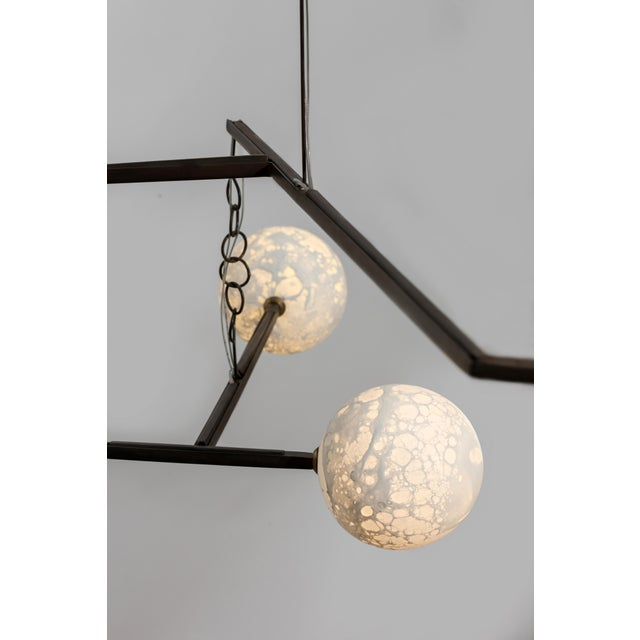 Ludovic Clément d'Armont Blown glass and metal (can also be made in brass) Dimensions of the moons: can vary in the...
