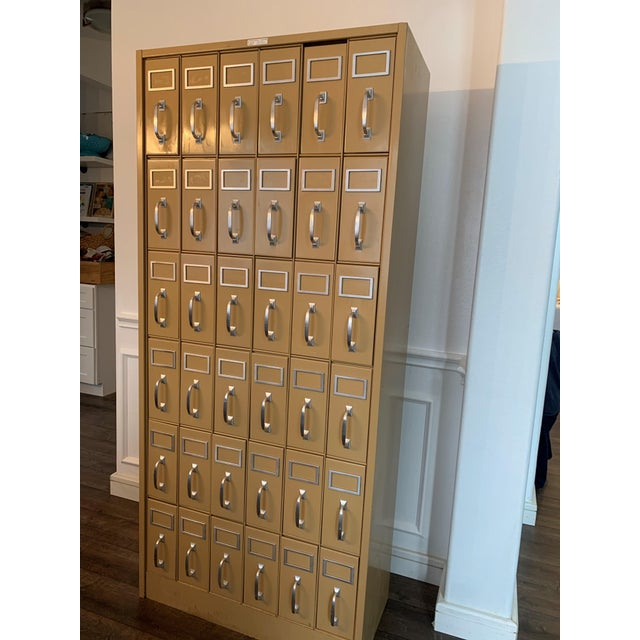 A Large Vintage metal courthouse ledger file cabinet with 36 drawers arranged veritcally in 6 rows of 6. With a classic...