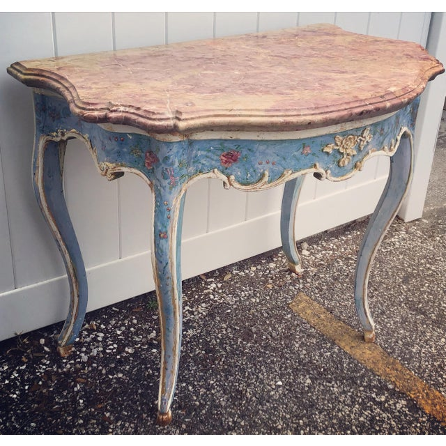 Venetian hand painted Console Table with Rouge Marble Top. Blue ground with beautiful worn patina painted with floral...