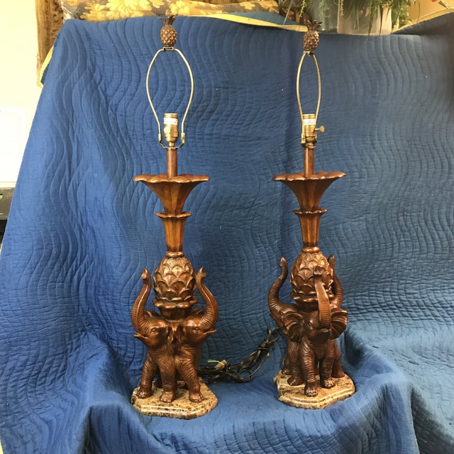 Stunning pair of table lamps. Exquisitely detailed elephants stand on a stone base. These gorgeous lamps would be a...