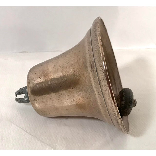 Love this very old and very used brass bell. This piece would make a great paper weight.