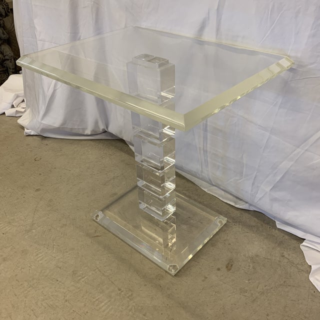 Very cool vintage lucite end or side table. The pedestal is stacked cubed lucite with think lucite base and top. Fair...