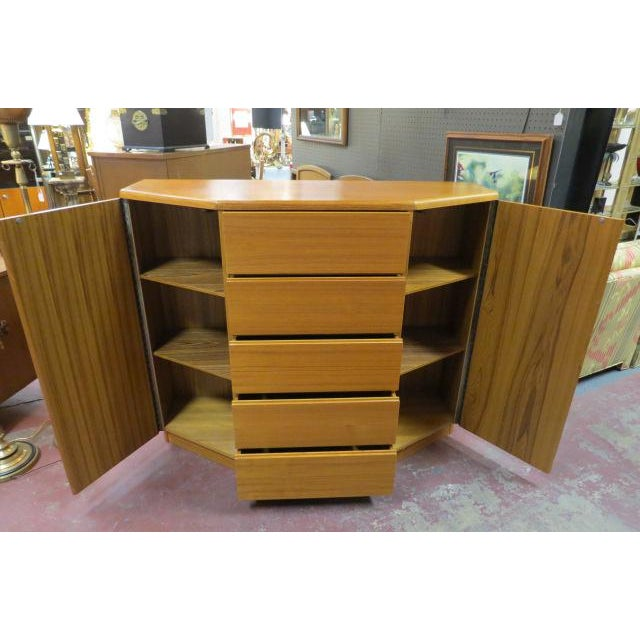 Sleek Storage! Vintage Danish modern teak cabinet/chest/dresser, c. 1960. 5 front drawers. 1 door on each side. 2 shelves...