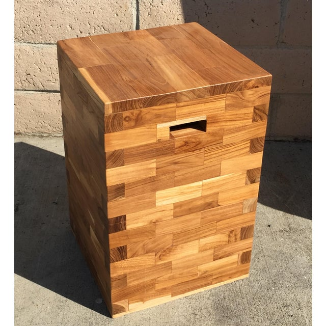 This teak wood stool or end table is made with thick pieces of reclaimed teak. There are a couple of cut outs on opposite...