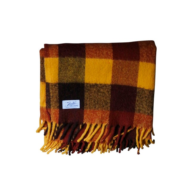 A vintage yellow, orange and brown plaid wool blanket, made by Faribo of Faribault, Minnesota. Great for use as a picnic...