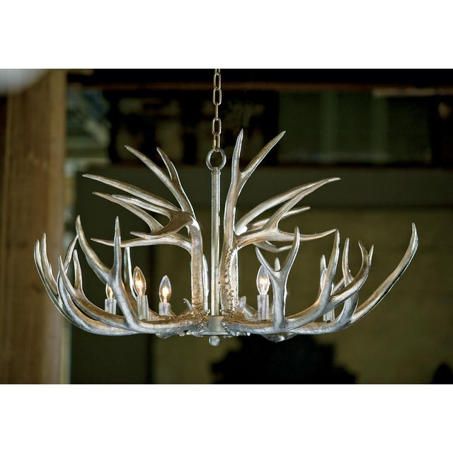 Wildlife gone glam. The resin Antler chandelier wears a metallic Ambered Silver Leaf to bring a beautiful sheen to a...