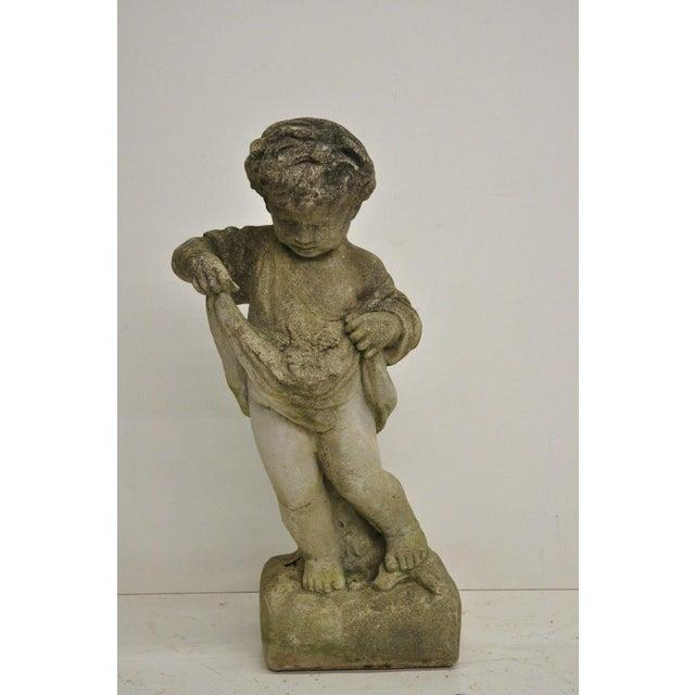 A pair of cement four seasons baby cherub garden statue sculpture. Item features 60 lbs. each, very nice details, cherubs...