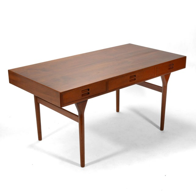 This elegant design by Nanna & Jørgen Ditzel serves as a desk, a writing table, library table, or even a console table in...