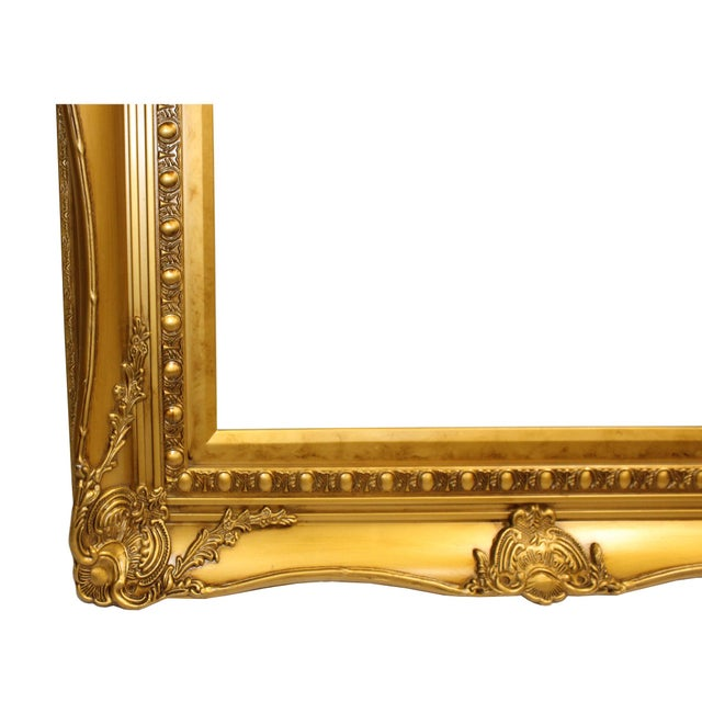 """This is a wooden frame for painting or picture with scroll pattern rim in the golden color paint finish. Dimensions: 28.5""""..."""