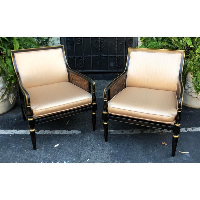 Hollywood Recency Black & Gold Cane Arm Low Club Chairs - a Pair