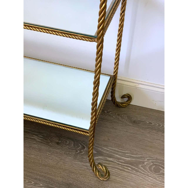 "Large Hollywood Regency Italian gilt metal 'Rope' Etagere with four 27"" x 13"" shelves. Includes three glass shelves and..."
