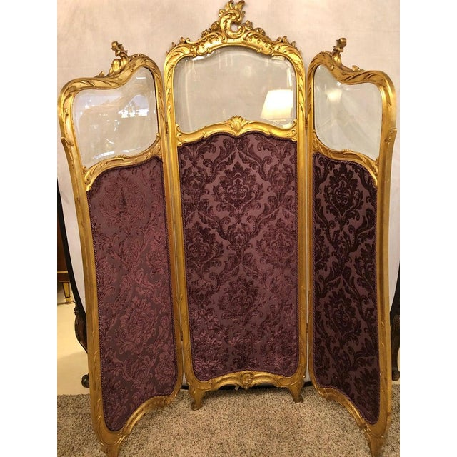 Fine Louis XV style giltwood three fold screen with original glass panels newly upholstered in a cut velvet amethyst color...