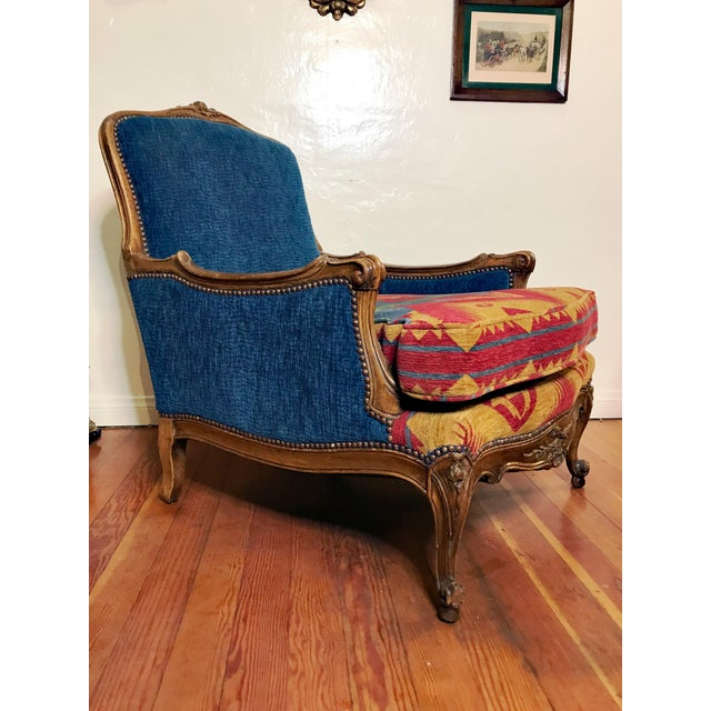 One of a kind luxury. A French Carved wood armchair, reupholstered recently, main fabric navy blue, with two removable...
