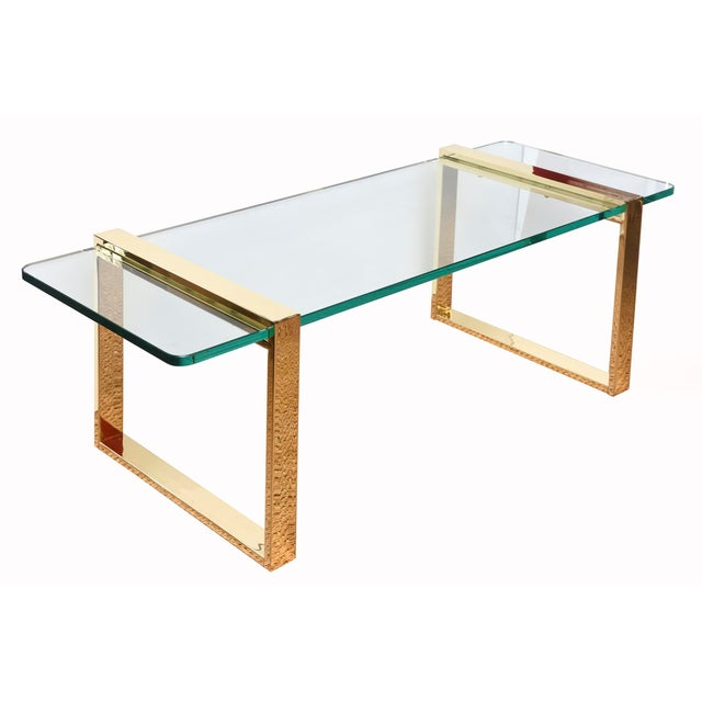 This stunning Leon Rosen for Pace real and authentic 24 Karat gold plated and glass cocktail table is also a small library...
