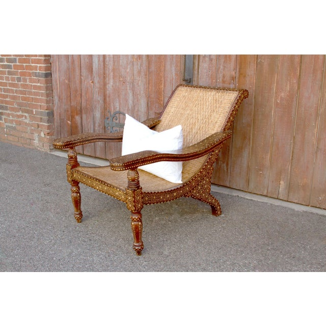 Anglo-Indian rosewood bone inlay cane seat lounge chair. This piece is all inlaid by hand and adorn with beautiful florate...