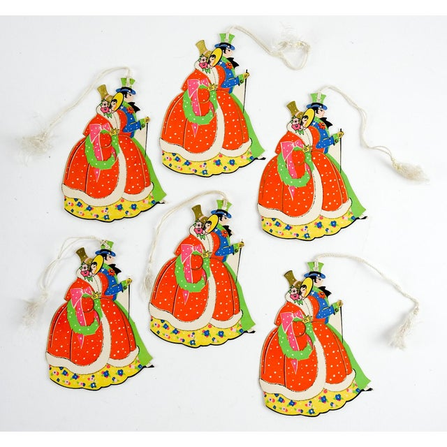 Group of 6 vintage circa 1930's Christmas sweethearts die cut tally cards with silk tassels. Unused, red, green, blue,...