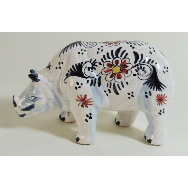 French faience blue and white rhinoceros attributed to Desvres, circa 1910. Minor hairlines on the glaze.