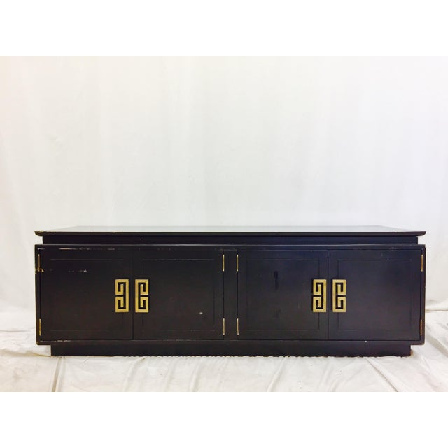 Stunning vintage mid century era Asian modern style credenza with original gold brass hardware and black finish. Ming...
