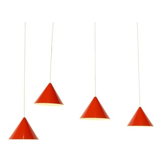 Four billiard lamps with orange conical metal shades by Louis Poulsen