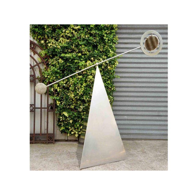 Marc Cavell (1911-1989) Stabile Metal and granite stone France, circa 1970 Unique piece Measure: H 230 x W 230 x D 105 cm.