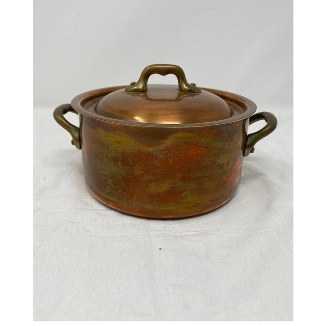 """Small copper pot with brass handles and lid Measures: 6 1/2"""" diameter x 3 1/4"""" height 4 1/2"""" height overall x 8 1/2""""..."""