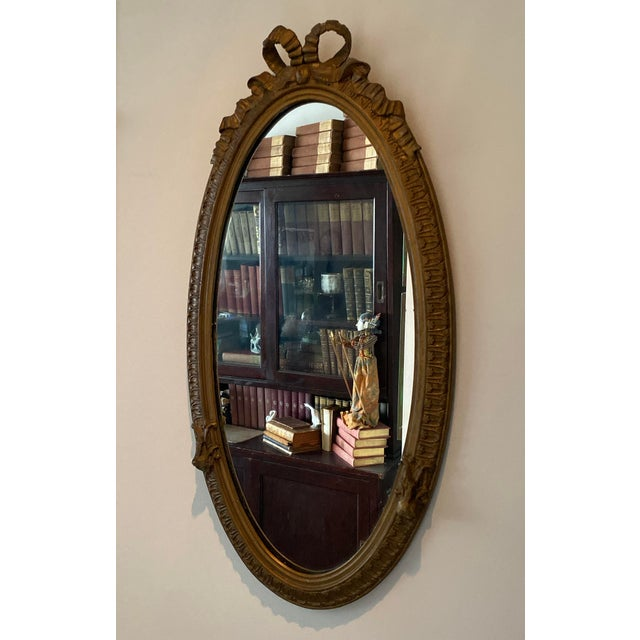 Louis XVI Carved Giltwood Mirror With Bow on top and embellishments on sides. Lovely carved details.