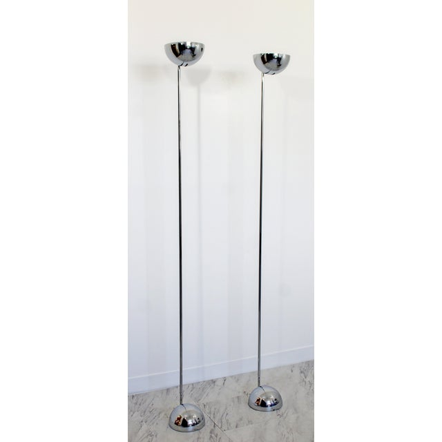 For your consideration is a luminescent pair of chrome, uplight, standing floor lamps, designed by Robert Sonneman, circa...