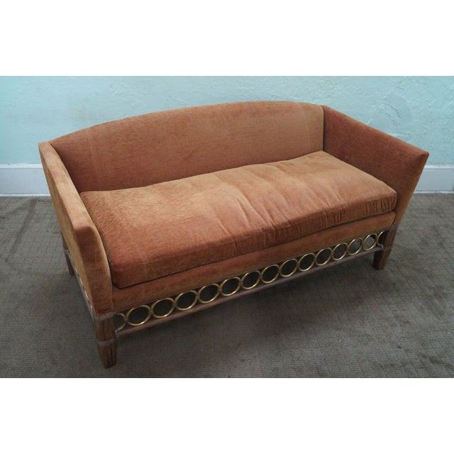 Store Item #: 8921 McGuire Laura Kirar pair of repeating circle rattan base upholstered sofas. Approx 15 years, America....