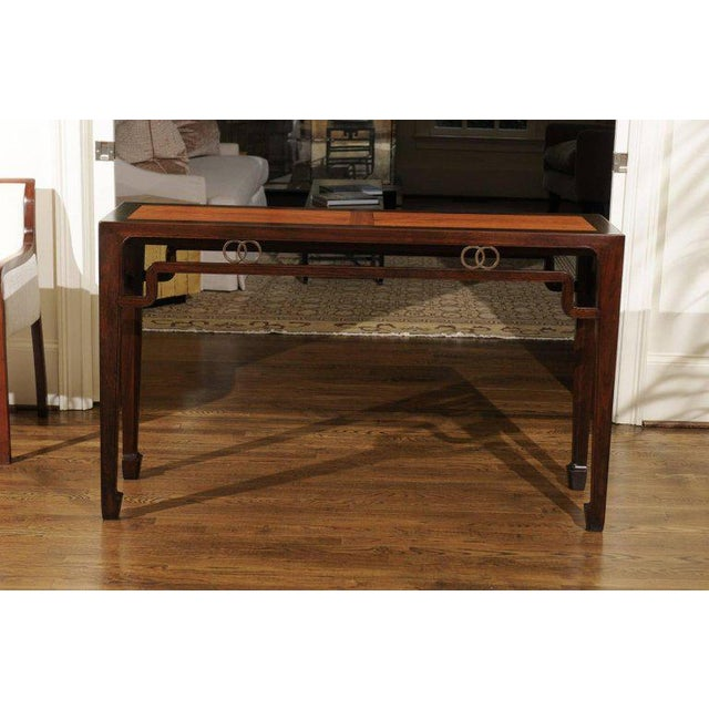 A majestic altar console table by Michael Taylor for Baker, circa 1970. Magnificent walnut construction with a handsome...