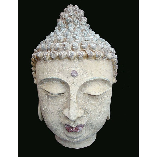 Reproduction of carved Buddha but cast in sturdy resin. This large decor buddha head has nice whitewashed details and warm...