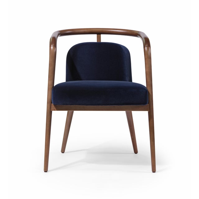 JAVIER GOMEZ Inspired by New York buildings and their unique style, the Essex Armchair was designed to complement...