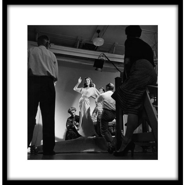 """Elaine Stewart being photographed by Ray Jones, 1953. 11"""" x 14"""" silver gelatin fiber based print signed on verso by the..."""