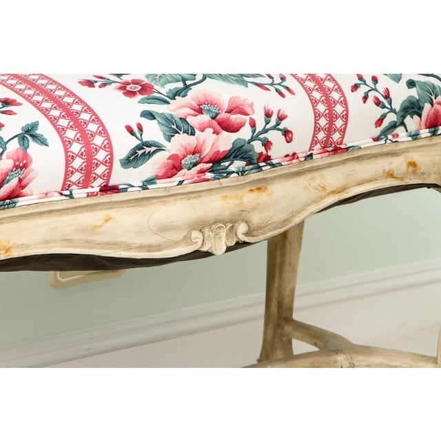 Elegant well-carved French Louis XV style bench custom upholstered in floral chintz fabric. This charming Louis XV bench...