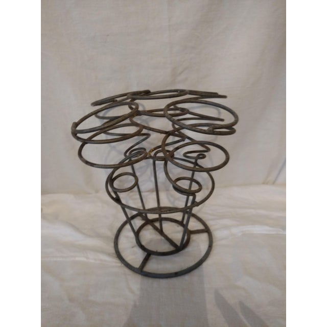 This 5 bottle spiral wire gray metal wine rack holder is perfect for your mini bar or small apartment. It has an...
