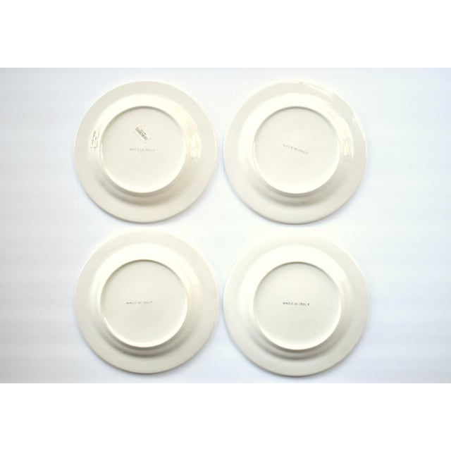 This is is a set of four (4) vintage small dessert, bread, or canape plates, printed with black and white neoclassical...
