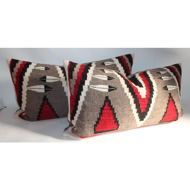 These fine early Navajo Indian weaving pillows are amazing condition with feathers and great colors. Sold as a pair for...