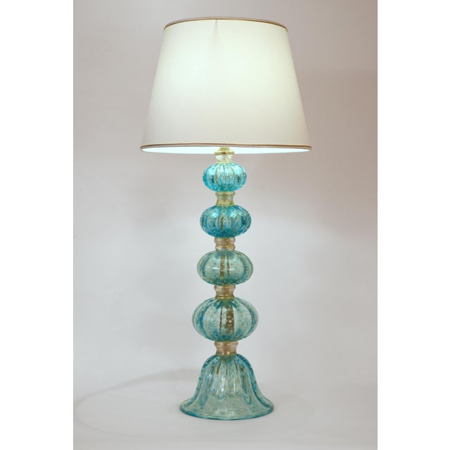 Exquisite light turquoise with gold flecks Murano glass table / task lamps. Each lamp is in excellent working condition....